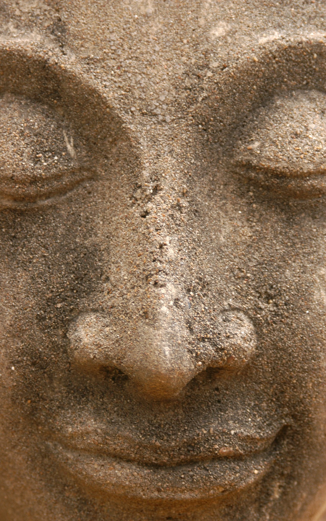 Stone face of Buddha from the temple of Wat Yai Chai Mongkol in Ayutthaya, Thailand